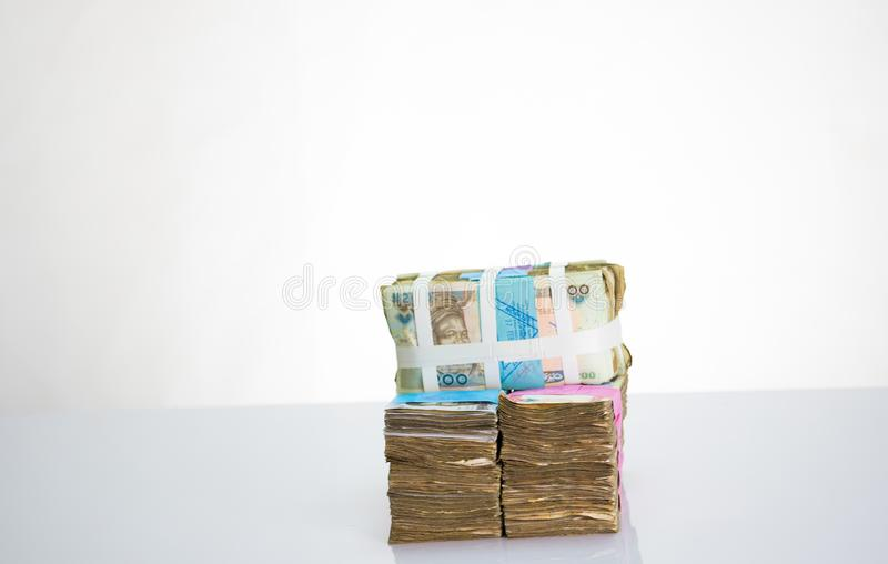 Stack of nigeria N1000 and N500 naira notes. Stack of nigeria naira notes on white background royalty free stock image