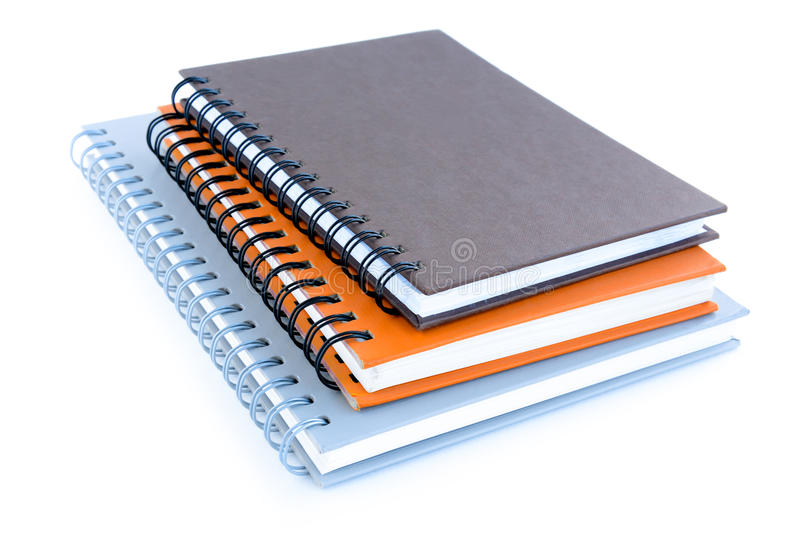 Stack of notebooks or copybooks on white background royalty free stock photography