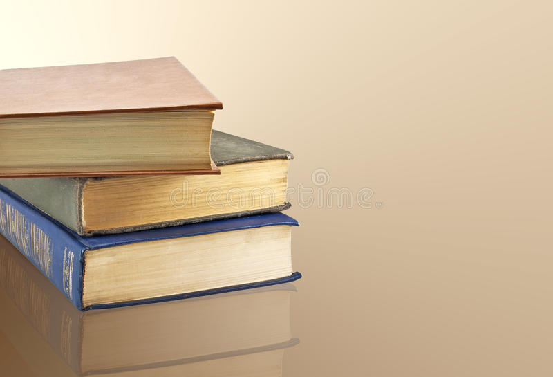 A stack of old books stock photos
