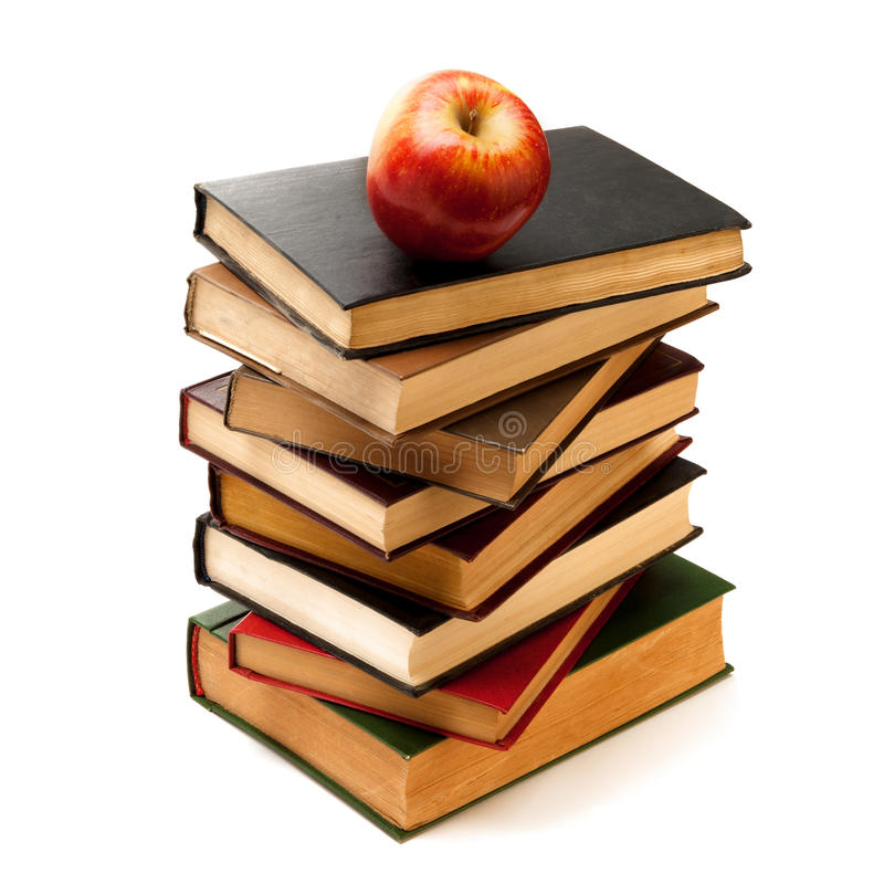 Stack of Old Books With an Apple on Top royalty free stock images