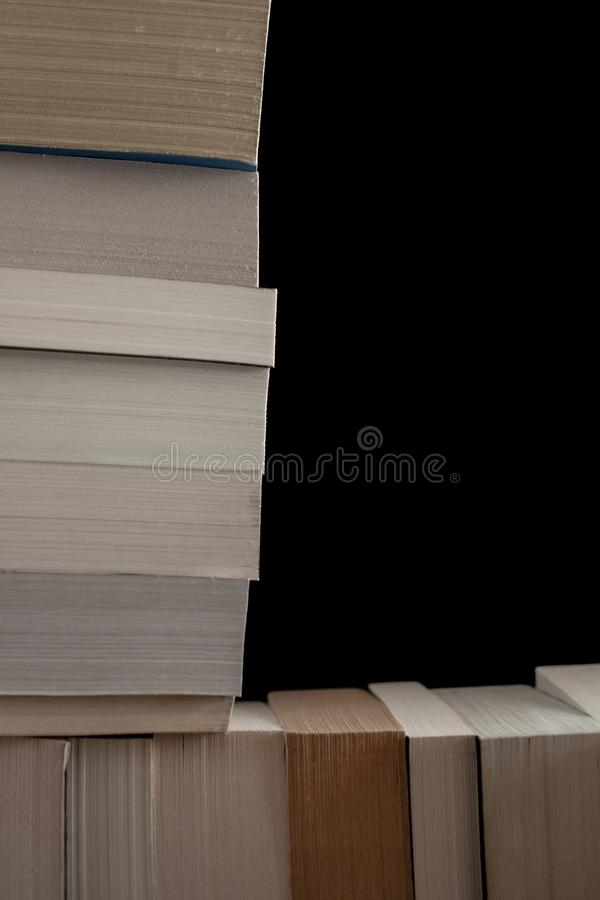 Stack of old books background. Many books piled together. Education and wisdom concept. Stack of old books background. Many books piled together. Education stock images
