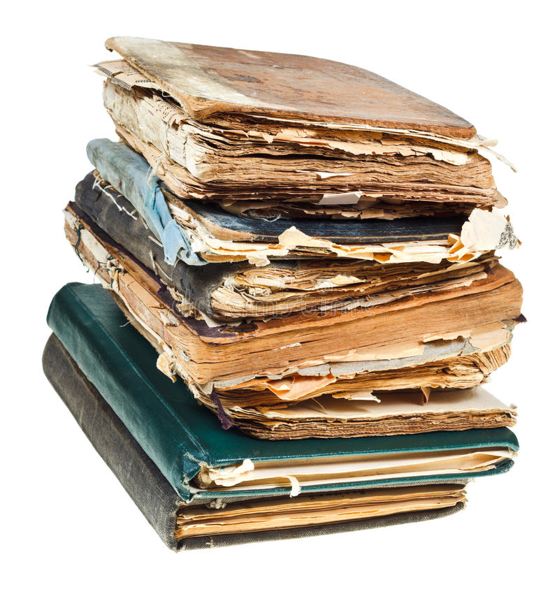 Stack of old books with pages torn out stock photos