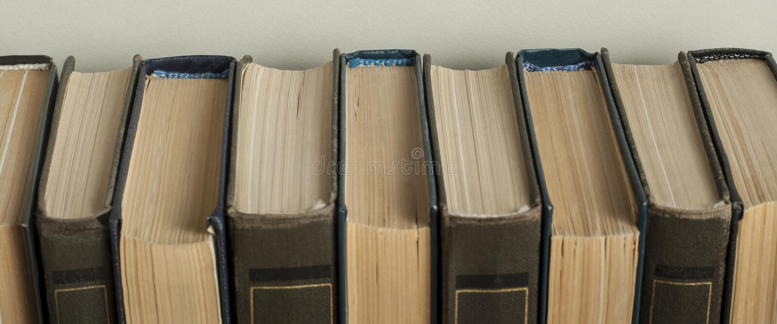 Stack of old books on wooden desk. Copy space for text. Back to school. Education background. royalty free stock photo