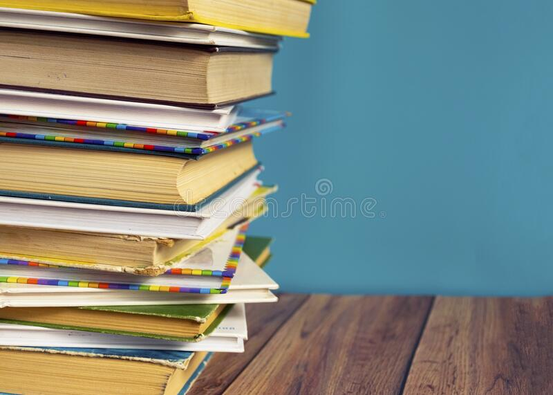 A stack of old books with yellow pages. Book binding. Knowledge and education. stock photo