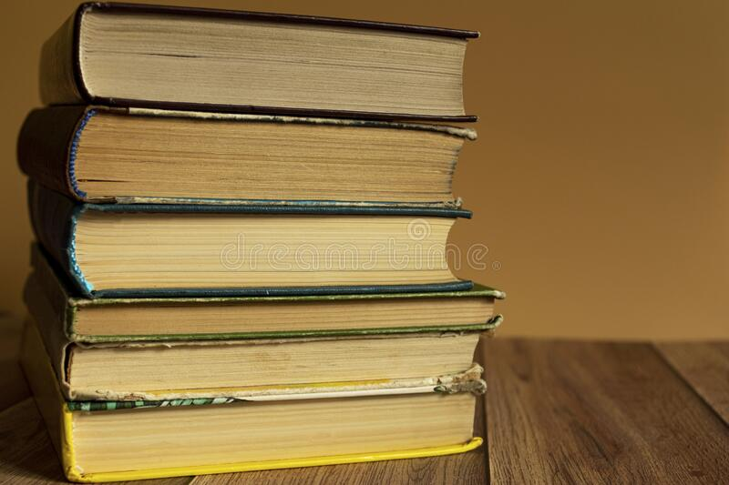 A stack of old books with yellow pages. Book binding. Knowledge and education. royalty free stock photography
