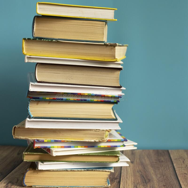 A stack of old books with yellow pages. Book binding. Knowledge and education. stock photography
