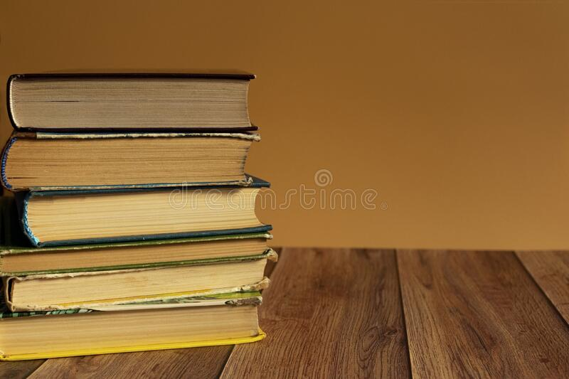 A stack of old books with yellow pages. Book binding. Knowledge and education. royalty free stock photos