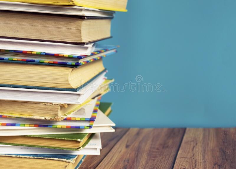 A stack of old books with yellow pages. Book binding. Knowledge and education. stock image