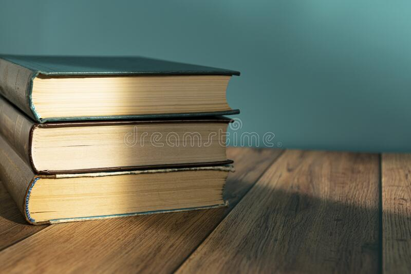 A stack of old books with yellow pages. Book binding. Knowledge and education. stock photos