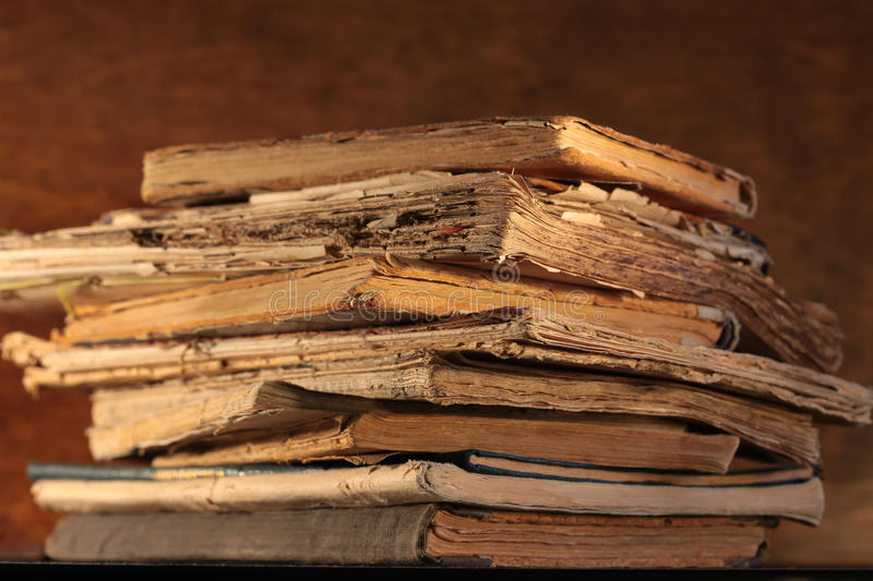 Stack of old books. A stack of old yellowed books closeup royalty free stock photos