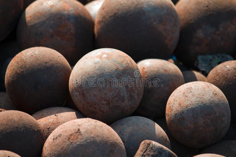 Stack of old colonial rusty cannon balls stock images
