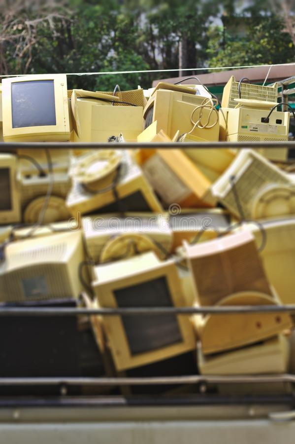 Stack of old computers, damaged many outdoor machines.old computer monitors in street royalty free stock images