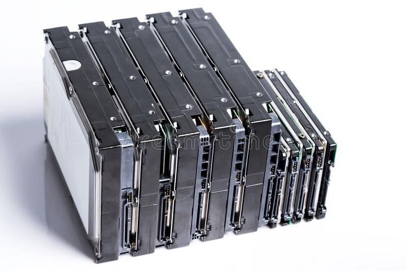 Stack of old hard drives on white background. Pile of old hard drives at white background royalty free stock images