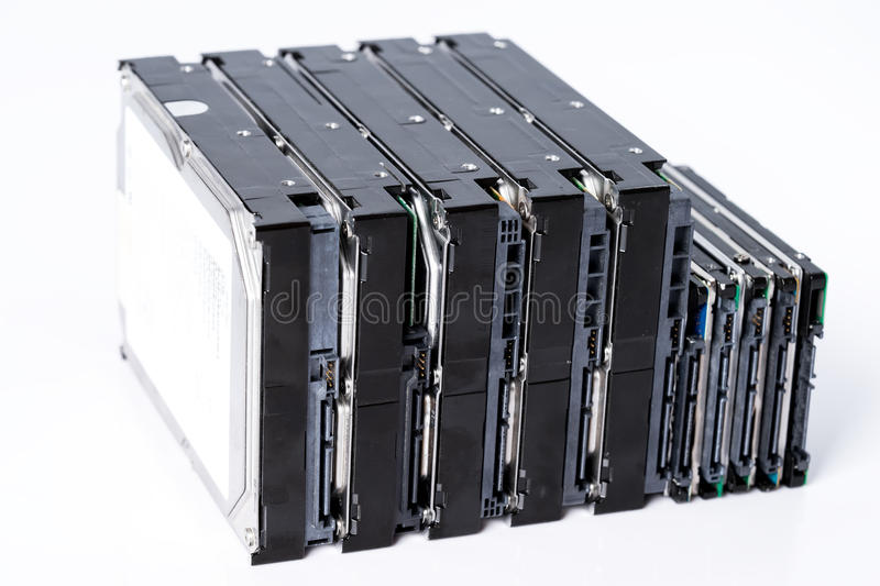 Stack of old hard drives on white background. Pile of old hard drives at white background stock photo