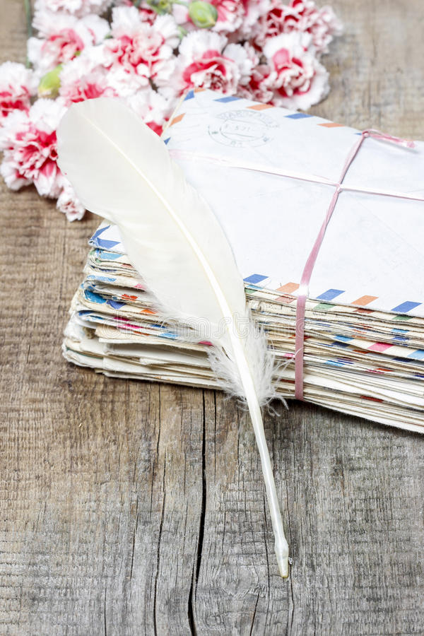Download Stack Of Old Letters, Feather Pen And Bouquet Stock Photo - Image of love, history: 39510612