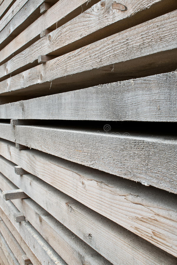 Stack of old lumber for construction. Architecture, structure, outdoor, interior, floor, wall finishing stock image