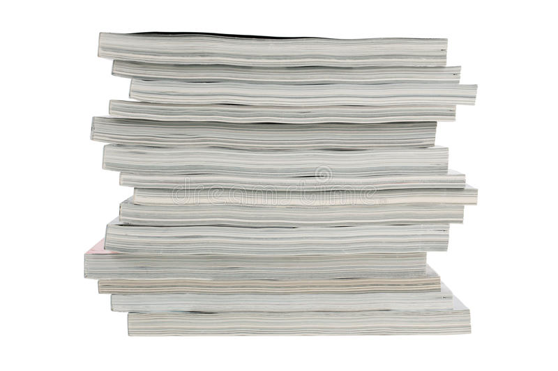 Stack of old magazines unnecessary. On a white background stock photo