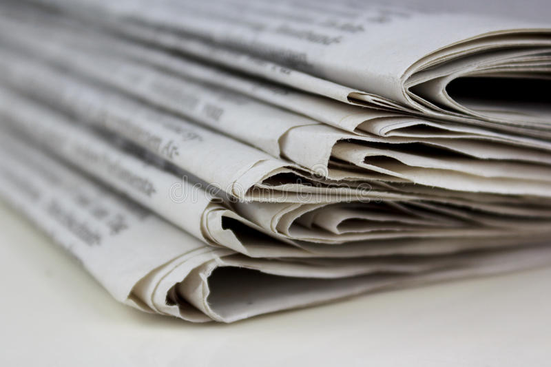Stack of old newspapers, pile of old newspapers royalty free stock images