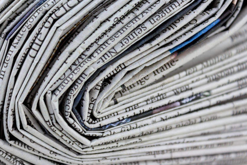 Stack of old newspapers, pile of old newspapers stock image
