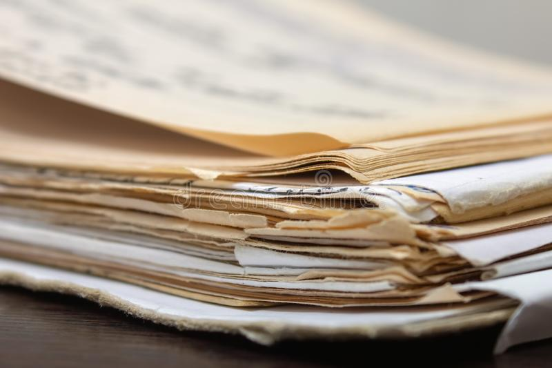 Stack of old paper documents. A pile of old paper documents. folder with yellowed papers. Yellowed old documents. Old book. Old manuscript on the table stock photo