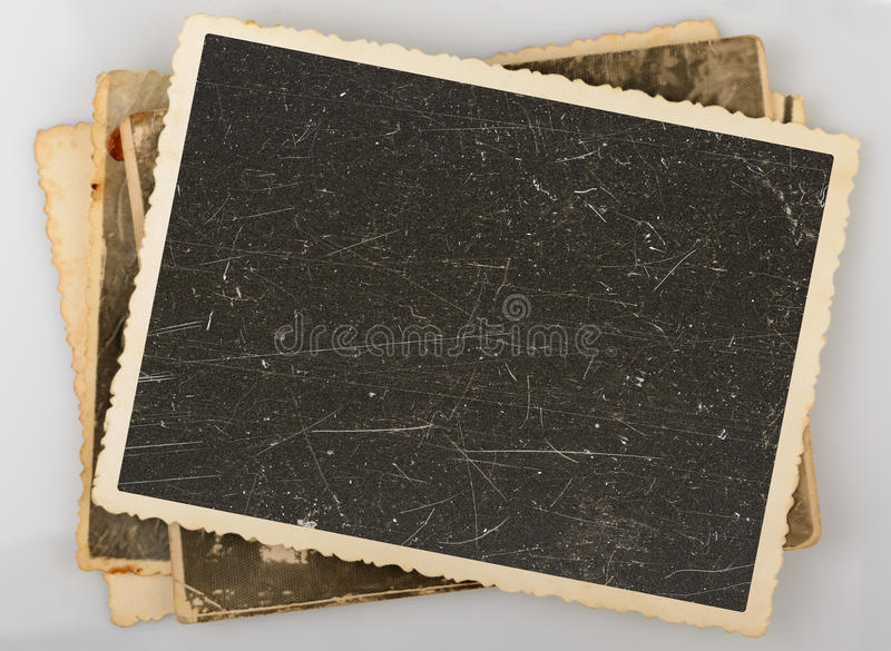 Stack of old photos. On grey background royalty free stock image