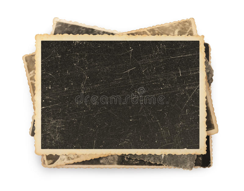 Stack of old photos isolated. On a white royalty free stock image
