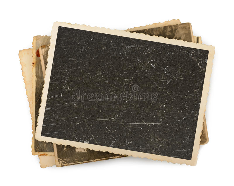 Stack of old photos isolated. On a white stock image