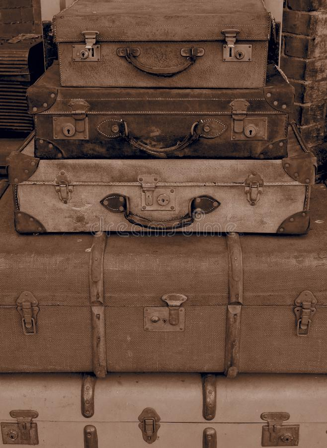 Stack of old suitcases on station platform royalty free stock image