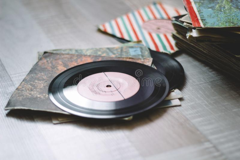Vinyl records. A stack of old vinyl records on a wooden floor stock photography