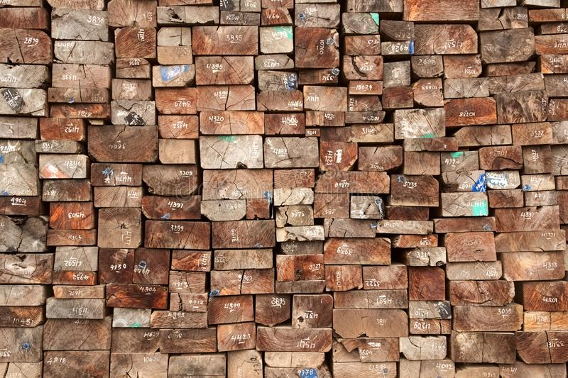 The stack of the old wooden sleepers for making a rail track royalty free stock photography