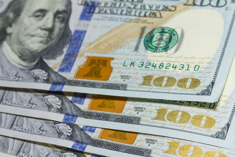 Stack of one hundred dollar banknotes close up with selective focus royalty free stock photo