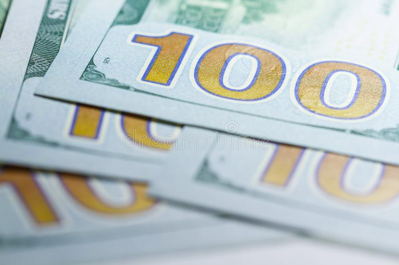 Stack of one hundred dollar banknotes close up with selective focus stock image