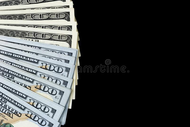 Stack of one hundred dollar bills. Stack of cash money in hundred dollar banknotes. Heap of hundred dollar bills isolated on black royalty free stock photos