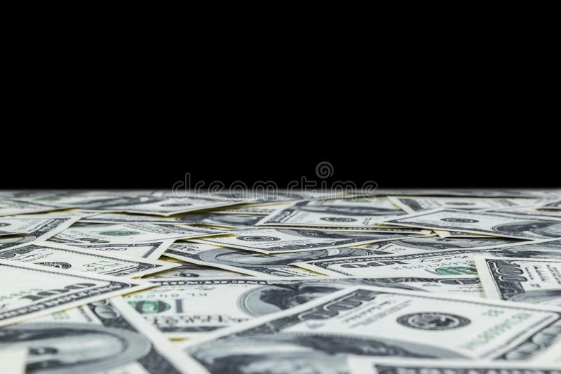 Stack of one hundred dollar bills isolated on black background. Stack of cash money in hundred dollar banknotes. Heap of hundred d. Ollar bills background stock images