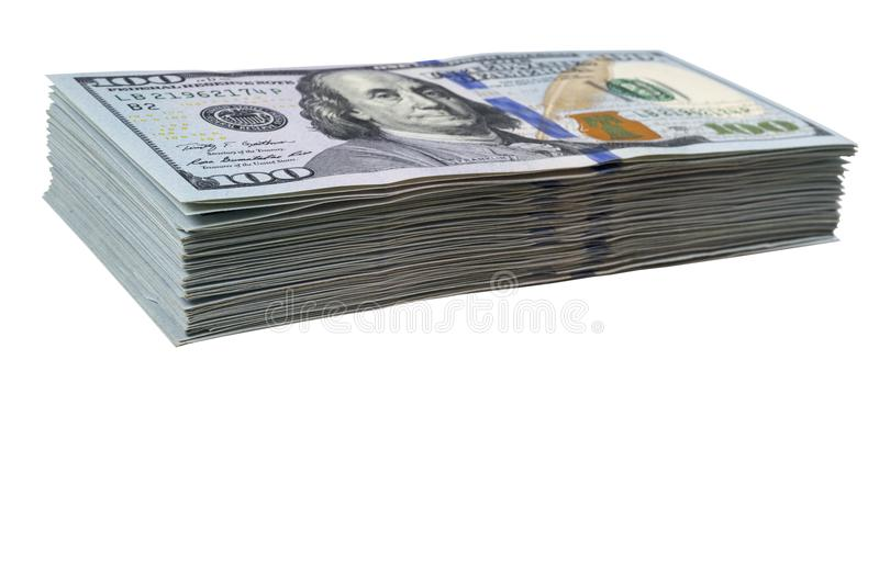 Stack of one hundred dollar bills isolated on white background. Stack of cash money in hundred dollar banknotes. Heap of hundred d. Ollar bills background stock photo