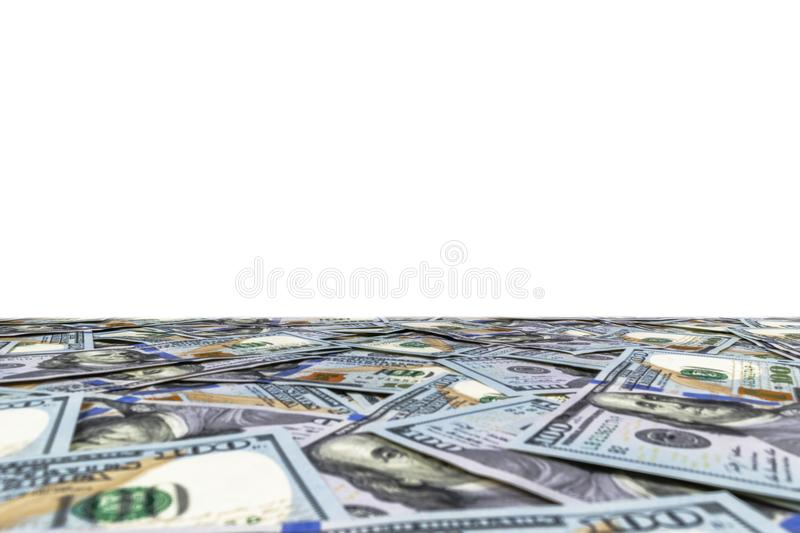 Stack of one hundred dollar bills isolated on white background. Stack of cash money in hundred dollar banknotes. Heap of hundred d. Ollar bills background royalty free stock image