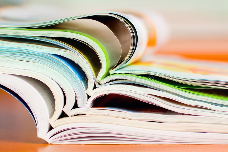 Stack of open magazine - soft focus royalty free stock photo