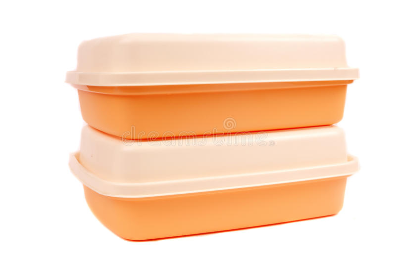 Stack of orange storage plastic containers. Isolated on white background stock image
