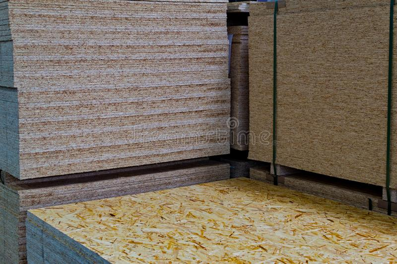 A stack of OSB sheets stacked one on another in store stock images