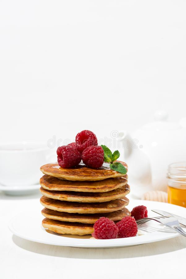 Stack of pancakes with fresh raspberries for breakfast, vertical. Closeup royalty free stock photography