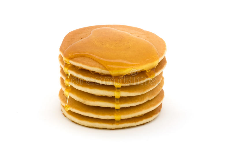 Stack of pancakes over white with syrup stock photo