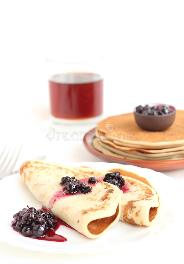 A stack of pancakes on a plate. On white background stock photography