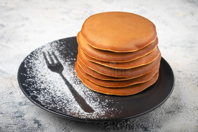A stack of pancakes on a plate, breakfast stock photo
