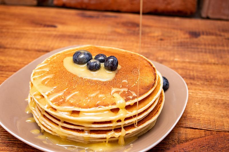 A stack of pancakes on a plate close-up.  stock photo