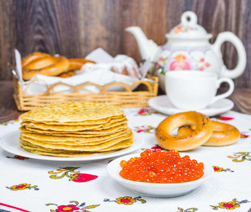 Stack of pancakes and red caviar royalty free stock images