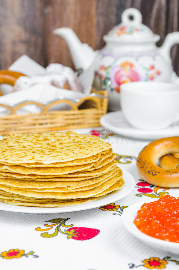 Stack of pancakes and red caviar stock photos