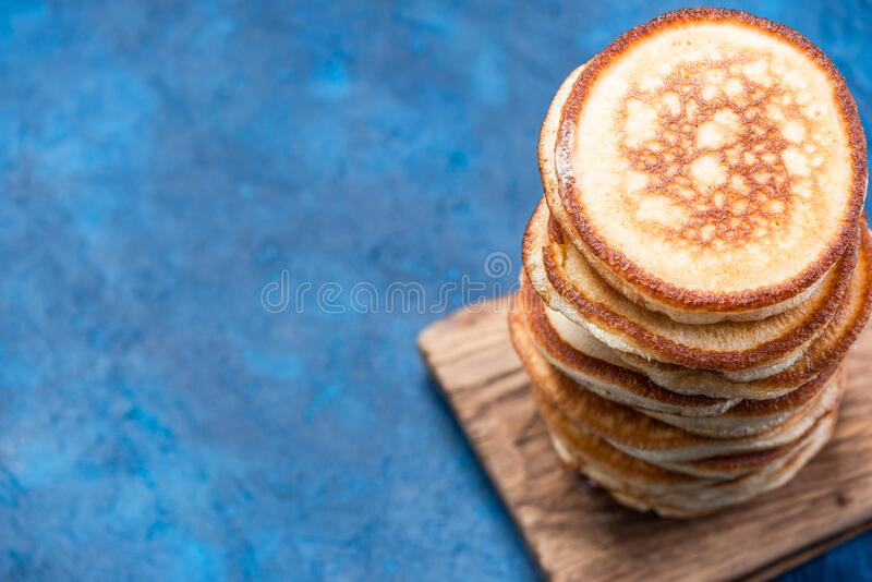 Stack of Pancakes on Wooden Board. Overhead View. Border Background.  stock photo