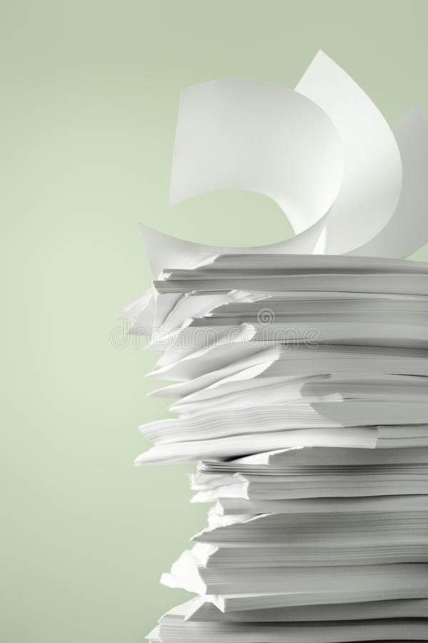 Stack of Papers. Against a plain color background stock photography
