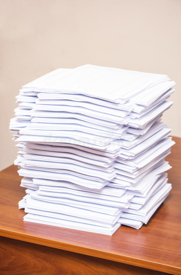 A stack of papers. On desk royalty free stock images