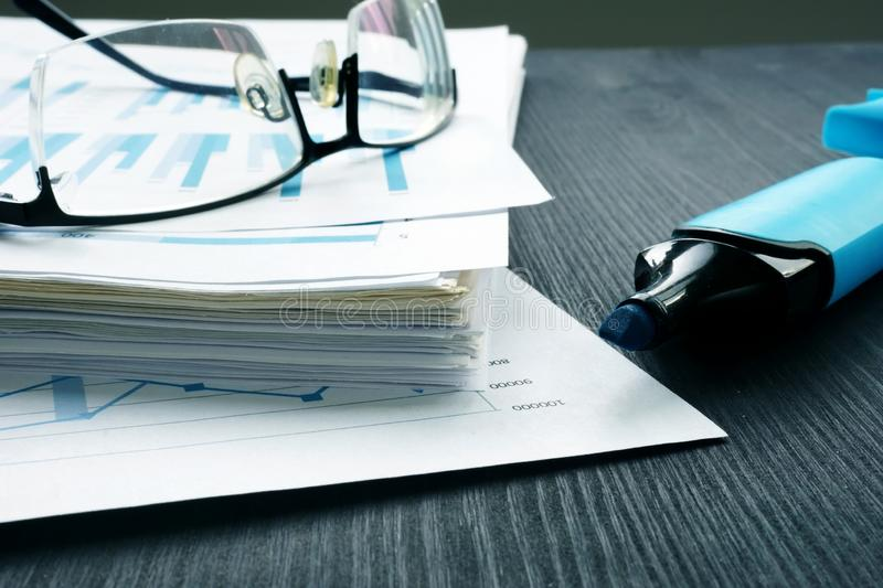 Stack of papers with financial report and glasses. Internal audit and assessment royalty free stock images